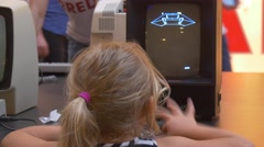 Little Girl is Playing Old Computer Game Spaceship Black and White Inage on a Stock Footage