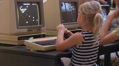 the Small Fair-Haired Girl Plays Computer Games With the Help Joystick - stock footage
