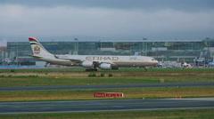 Etihad Airbus 340 taxiing Stock Footage
