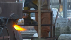 Man Approaches to Burning Furnace Casting Workshop People Molting Metal Worker Stock Footage
