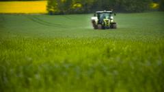Spreading Pesticides in Springtime - stock footage