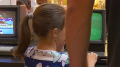 Father Helps Daughter Get to Next Level of Game Stock Footage