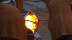 People Working on Metal Casting at Foundry Liquid Iron is Pouring From a Ladle Stock Footage