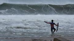 NSW, AUSTRALIA - JUNE 2016: bodyboarder surfer big stormy sea waves from cyclone - stock footage