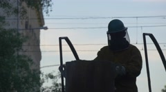 Man's Silhouette in Helmet on a Top of Furnace Casting Workshop People Molting Stock Footage