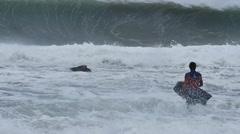 NSW, AUSTRALIA - JUNE 2016: bodyboarder surfer massive waves stormy sea - stock footage