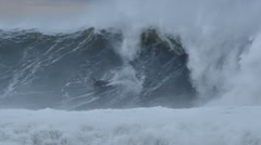 NSW, AUSTRALIA - JUNE 20 Bodyboarder surfing massive waves of coast during storm - stock footage
