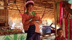 Long Neck woman in hill tribe village near Chiang Mai, Thailand Stock Footage