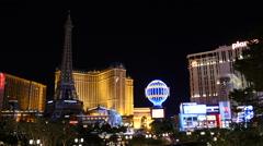 Paris Casino and the Las Vegas Strip at Night Stock Footage
