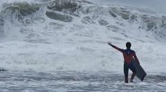 NSW, AUSTRALIA - JUNE 2016: bodyboarder surfer big waves and rough ocean Stock Footage