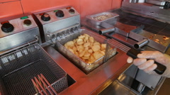 Preparation of deep fried potato chips - stock footage