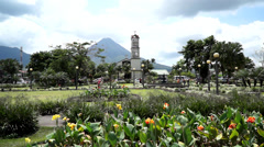 Church in La Fortuna town and Volcano Arenal, Costa Rica Stock Footage