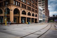 Light rail tracks and buildings in downtown Minneapolis, Minnesota. Stock Photos