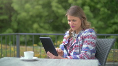 Young woman using a tablet Stock Footage