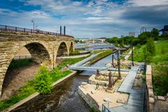 Ruins at Mill Ruins Park and the Stone Arch Bridge, in downtown Minneapolis,  Stock Photos