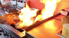 Flaming grill in a restaurant Stock Footage