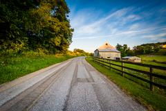 Barn and fence along a dirt road, near Jefferson in rural York County, Pennsy Stock Photos