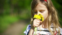 Playing with Dandelion Flowers on Meadow in Park - stock footage