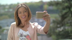 Young woman taking a selfie with a smartphone Stock Footage