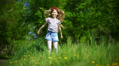Adorable little girl dancing in the park - stock footage