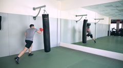 Fighter Trains With Punching Bag In The Gym - stock footage