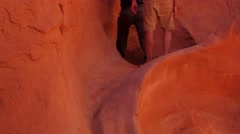 Men hiking gorgeous narrow slot canyon in the desert of Utah Stock Footage