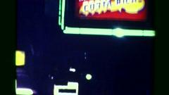 1976: Cerrajeria neon light sign flashing nighttime urban city lights. SAN JOSE, Arkistovideo