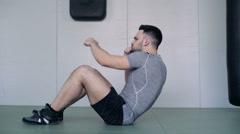 Young Fighter Shakes Abdominals On The Floor Stock Footage