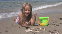 Young Girl Playing Pebbles on Beach, Portrait Child, Kid on Seashore, Summer - stock footage