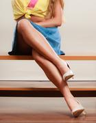 Closeup of sexy woman legs in high heels and skirt - stock photo