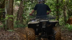 ATV drive through mud puddle - stock footage