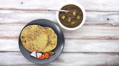 Gujarati flatbread Methi Thepla served with Punjabi Palak Paneer Stock Footage