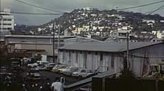 Martinique 1977: parking lot in the suburbs of a city Stock Footage