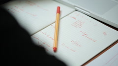Exam as a test written in red pen lined exercise book Stock Footage