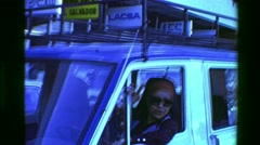 1976: Gypsy woman driving car yapping gums sticking head out window. SAN JOSE, - stock footage