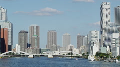 Wide View of Sumidagawa River with High Rise Buildings in Time Lapse Stock Footage