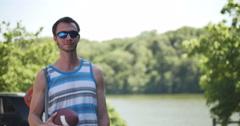 Beach Fun at Lake Young Man with Fishing Pole Walking to Water, 4K Stock Footage
