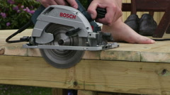 Close up of a man who saws with an electric saw in the wood Stock Footage