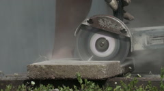 Close up of a man cutting a concrete slab with a electisk saw Stock Footage