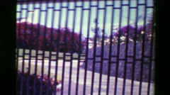 1976: Wealthy mansion home behind gated bars walled community.  SAN JOSE, COSTA Stock Footage