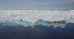 Sea Ice bergs reflection on sunny arctic day Stock Footage