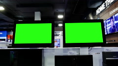 Display tv with green screen inside Best buy store Stock Footage