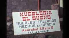 1976: Muebleria el Sueno handmade furniture storefront sign market shop.  SAN Stock Footage