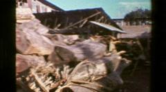 1976: Lumberyard tree cut wood pile stacks log timber factory. SAN JOSE, COSTA Stock Footage