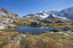 small mountain lake long an high path in South Tyrol - stock photo