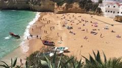 Boats and tourists at Praia de Carvoeiro Stock Footage