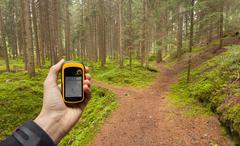 finding the right position in the forest via gps - stock photo