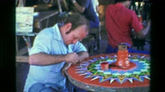 1976: Men painting crafts tables design relaxing training arts drawing. SAN Stock Footage