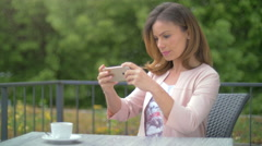 Young woman taking a selfie with a smartpone Stock Footage