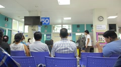 Patients Waiting Queue for Seeing a Doctor in Hospital Stock Footage